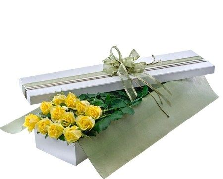 Dozen yellow roses in a box